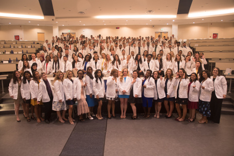 Incoming American University of the Caribbean School of Medicine students in their newly-received white coats. (Photo: Business Wire)