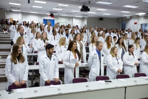 Ross University School of Medicine students participate in the 2019 White Coat Ceremony. (Photo: Business Wire)