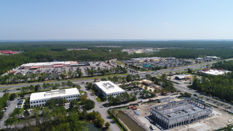 A third office building and a Starbucks are under construction at Beckrich Office Park in Panama City Beach, FL. Once complete the St. Joe Company corporate headquarters will occupy a portion of the new office building. (Photo: Business Wire)