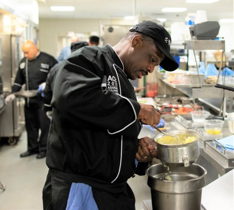 Aramark chef Tracey Hopkins, Sr., competes during the Healthcare sector finals of the Aramark Culinary Excellence Competition. (Photo: Business Wire)