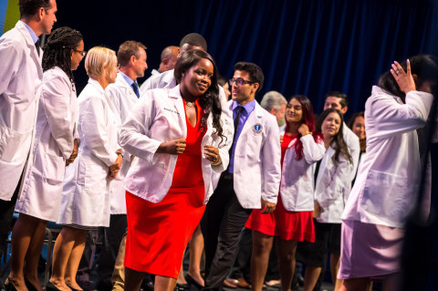 Ross University School of Medicine Students receiving their white coats. (Photo: Business Wire)