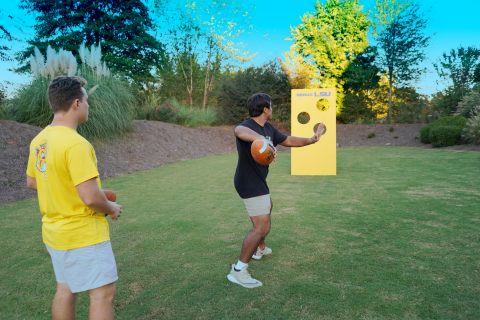 The football toss is a great way to keep guests entertained during pregame, media breaks or halftime at your next game day gathering. (Photo: Exmark)