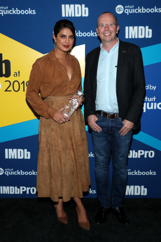 IMDb Founder and CEO Col Needham presents the IMDb STARmeter Award to Priyanka Chopra Jonas at The IMDb Studio Presented By Intuit QuickBooks at Bisha Hotel & Residences on September 07, 2019 in Toronto, Canada. (Photo by Rich Polk/Getty Images for IMDb)
