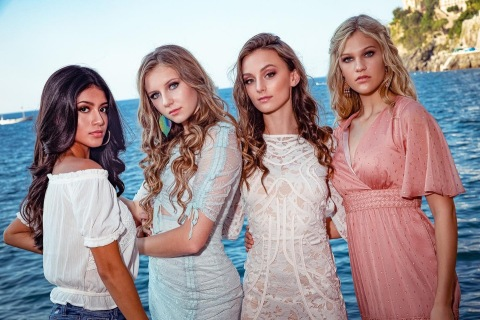 """U.S. fashion models Joscelyne Delgado, Ellie Matus, Madeline Berl, and Georgia Potts from Australia (on far right) are just some of the young, top fashion models from around the world who attend the large, educational event called """"Fashion Passport"""" each year. This year's """"Fashion Passport 2020"""" will take place in Monument Valley, Utah and Arizona from June 30-July 5. (Photo: Business Wire)"""