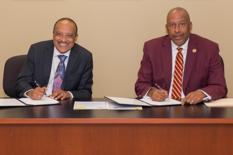L-R: Dr. William F. Owen, RUSM dean and chancellor and Dr. Thomas Parham, CSUDH president (Photo: Business Wire)