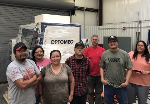 NTU students receive the Optomec LENS MTS 500 HY CA system (Pictured from left to right: Aaron Sansosie, Adriane Tenequer, Lisa Willis, Chad Yazzie, Scott Halliday, Joshua Toddy and Les Notah). Photo courtesy of NTU and Optomec.