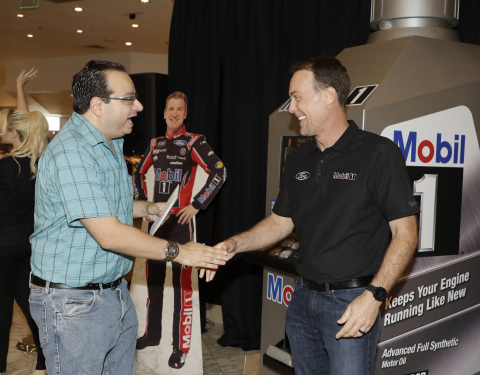 NASCAR driver Kevin Harvick at the Mobil 1™ 250K Mile Slot Machine, where fans had the chance to trade up from conventional motor oil to Mobil 1™ synthetic motor oil. (Photo: Business Wire)