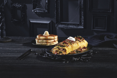Available as part of the IHOP Addams Family menu, Gomez's Green Chile Omelette is made with marinated pulled pork, jack & cheddar cheese, fire-roasted peppers & onions, and a green chile verde sauce topped with sour cream. (Photo: Business Wire)