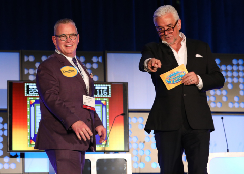 """Incoming NAMB president Kimber White plays """"Funding Feud"""" sponsored by Velocity Mortgage Capital and hosted by actor and television personality John O'Hurley. (Photo: Business Wire)"""