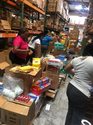 BTC employees preparing supplies for evacuees (Photo: Business Wire)