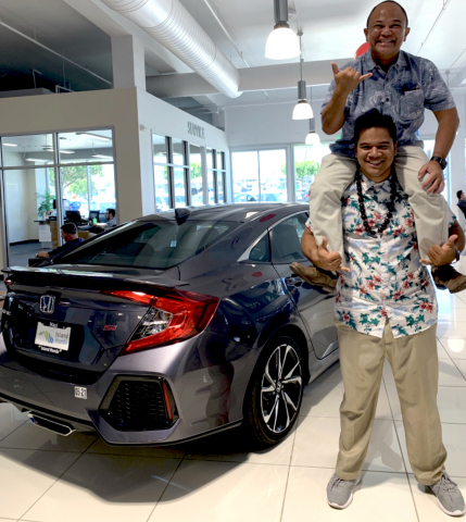"Island Honda team members having fun at one of the ""Best Dealerships to Work For."" (Photo: Business Wire)"
