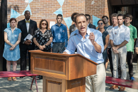 Congressional Candidate Michael Hiller speaking to a crowd in front of the Cortelyou Brooklyn Library (Photo: Business Wire)
