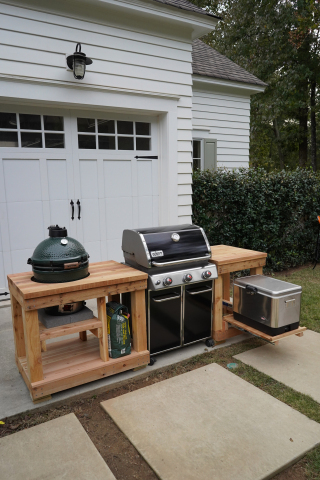 The outdoor cooking island ties together the smoker, grill and cooler, while adding valuable countertop space. (Photo: Exmark)