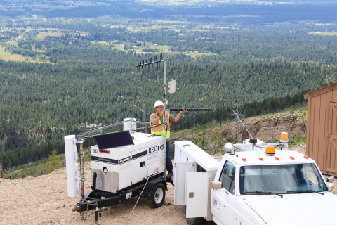 Ravalli Electric Cooperative's IT specialist tests a remote communication site on a mountaintop in Hamilton, Montana. (Photo: Business Wire)