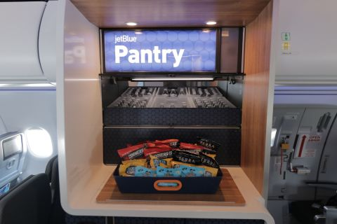JetBlue's take on an inflight snack bar -- The Pantry® -- has been completely reinvented and will serve as an onboard gathering place for customers to stretch their legs and grab a free refreshment or some extra snacks throughout the flight. (Photo: Business Wire)