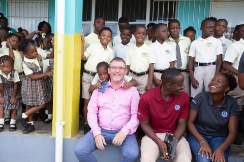 Dr. Sean Callanan, dean of Ross University School of Veterinary Medicine, meets with students at the Bronte Welsh Primary School in the Federation of St. Kitts and Nevis. (Photo: Business Wire)