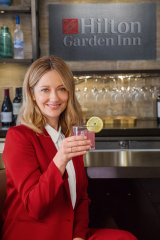 Hilton Garden Inn, a dining and drink leader in the upscale hotel category, is shaking up its cocktail menu with the help of award-winning actress Judy Greer. The star of Hilton Garden Inn's ad campaign since 2017, Judy has now joined forces with the hotel brand to create a new specialty cocktail, Judy's Garden Gin. Credit: Hilton Garden Inn