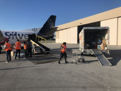 Silver Airways team members load supplies for relief flight to Freeport, Grand Bahamas (Photo: Business Wire)