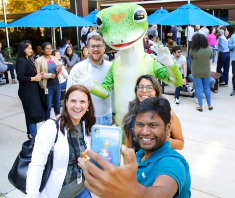 Associates take a group selfie with the Gecko at the recent Founders' Day celebration at GEICO headquarters. (Photo: Business Wire)