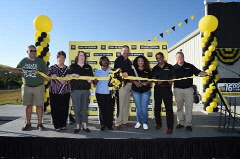 Donation recipients, Dollar General representatives and city leaders cut the official grand opening ribbon. Photo by Tim Allen Photography.