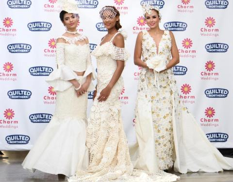 A Design by Mimoza Haska from Surfside Beach, SC (Center) is crowned the winner of the 15th Annual Toilet Paper Wedding Dress Contest presented by Charm Weddings and Quilted Northern in New York City. The runway show finale event, broadcast on national television on Monday, September 30th, revealed the $10,000 contest winner and featured the top 12 designs from more than 1500 entries crafted out of nothing more than Quilted Northern bath tissue and tape, glue or needle and thread to create intricate wedding gowns and accessories. (Photo by Charm Weddings/Quilted Northern®)