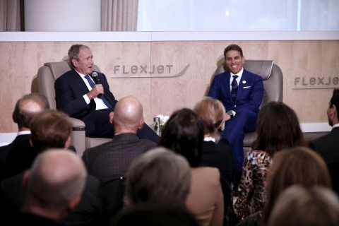 President George W. Bush (Left) and Flexjet Chairman Kenn Ricci (Right) converse with each other and attendees of the inaugural Flexjet Forum. (Photo: Business Wire)