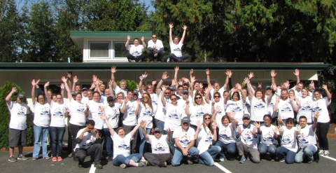 More than 80 team members at Navy Northwest Housing gather after serving Ryan's House for Youth, a drop-in center serving at risk youth at Whidbey Island.  The group installed drywall, flooring and landscaping, painted the center, and mentored youth. (Photo: Business Wire)