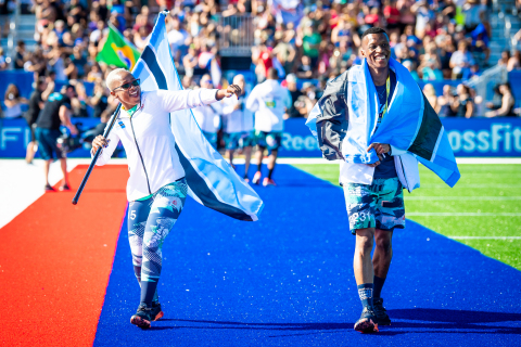 2019 Botswana National Champions Cingiwe Ciegy and Katlego Kgwadi wave to the crowd during this year's CrossFit Games. (Photo: Michael Valentin / Business Wire)