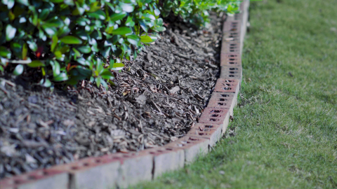Regardless of which border type you choose, maintenance with a string trimmer or edger is crucial to keeping borders looking their best. (Photo: Exmark)