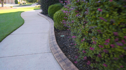Bricks or pavers are a good options for bed edging, though installation can be more challenging for homeowners due to the masonry skill required for mortaring. (Photo: Exmark)