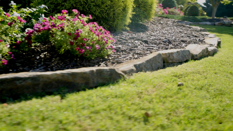 Natural stone is a popular option for bed edging due to its natural look. (Photo: Exmark)