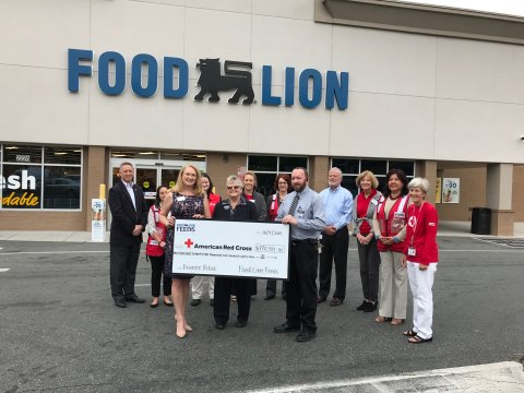 Food Lion associates Patty Holt and Mitch Hendrix present check to American Red Cross staff on behalf of Food Lion customers. (Photo: Business Wire)