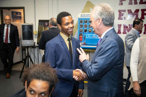 Louisville Mayor Greg Fischer greets Doss High School student leader Ghadi Nshimiyimani at the launch of a new mock assembly line today. (Photo: GE Appliances, a Haier company)