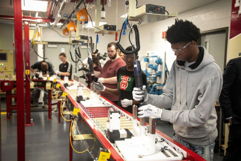 Doss High School students work on the new mock assembly line donated by GE Appliances that launched today. (Photo: GE Appliances, a Haier company)