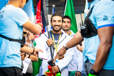 Afghanistan National Champion Sami Salampur smiles moments before taking the field at the opening ceremony at the 2019 Reebok CrossFit Games. (Photo: Michael Valentin / Business Wire)