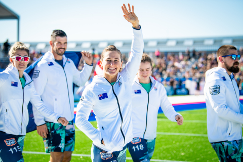 Tia-Clair Toomey, the three-time Fittest Woman on Earth and 2019 Australia National Champion, walks with her mates and waves to the crowd during the Opening Ceremonies at the CrossFit Games. (Photo: Michael Valentin / Business Wire)
