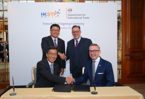 Mr. Albert Wong, Chief Executive Officer of Hong Kong Science and Technology Parks Corporation (1st row, left) and Mr. Paul McComb, Director General, Department for International Trade (1st row, right) signed a Memorandum of Understanding to establish a long-term and strategic relationship, witnessed by Mr. Andrew Heyn OBE, British Consul General to Hong Kong and Macao ( 2nd row, right) and Dr. Sunny Chai, Chairman of Hong Kong Science and Technology Parks Corporation (2nd row, left). (Photo: Business Wire)
