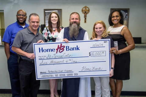 Home Bank and FHLB Dallas awarded $6K in Partnership Grant Program funds to St. Teresa for the Works of Mercy to benefit the organization's youth program. (Photo: Business Wire)