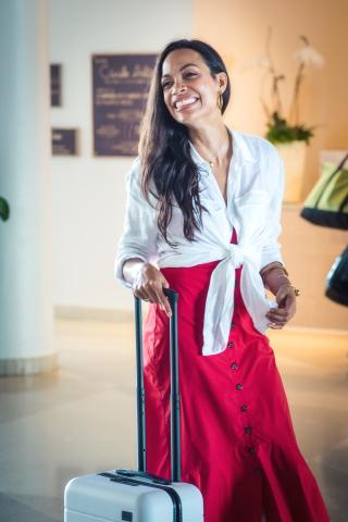Rosario Dawson at Caribe Hilton. (Photo: Business Wire)