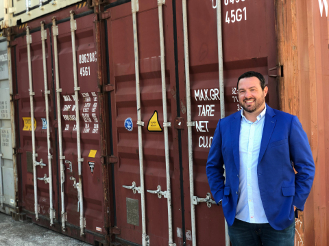 Railbox Consulting company president Mike Norton stands in front of shipping containers. (Photo: Business Wire)