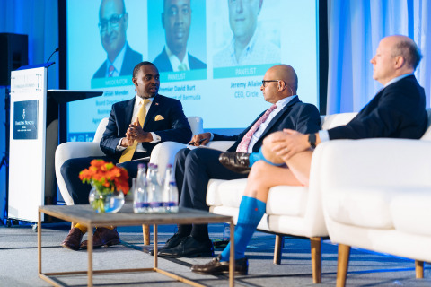 The keynote conversation between Bermuda Premier David Burt and Circle CEO Jeremy Allaire, moderated by Jessel Mendes, BDA Board Member and Partner at EY (Photo: Business Wire)