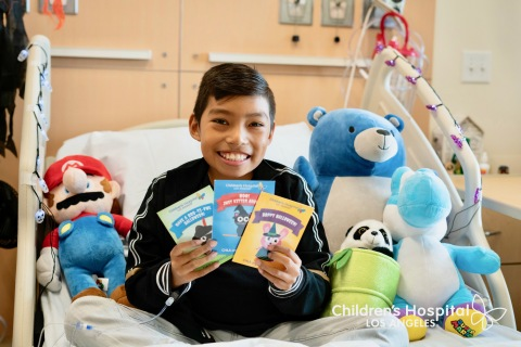 Children's Hospital Los Angeles patient Ethan, 11, displays the three Halloween-themed card images supporters can choose from on chla.org. (Photo courtesy of Children's Hospital Los Angeles)