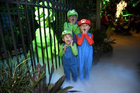 In this photo provided by Nintendo of America, fans of all ages experience fun photo ops, game demos and other Luigi's Mansion 3-inspired goodies at a preview event in Los Angeles on Oct. 18. Luigi's Mansion 3 is the latest game in the Luigi's Mansion franchise, with Luigi returning as the reluctant and cowardly hero, tasked with saving his friends from a spooky hotel. Luigi's Mansion 3 launches exclusively for the Nintendo Switch system on Oct. 31.