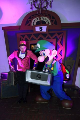 In this photo provided by Nintendo of America, Luigi from the Luigi's Mansion 3 game poses with his handy Poltergust G-00 at a preview event in Los Angeles on Oct. 18. Luigi's Mansion 3 is the latest game in the Luigi's Mansion franchise, with Luigi returning as the reluctant and cowardly hero, tasked with saving his friends from a spooky hotel. The game launches exclusively for the Nintendo Switch system on Oct. 31.