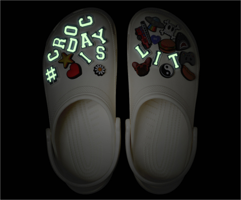 This year's limited edition #CrocDay Classic Clog will come fully loaded with a curated assortment of custom #CROCDAYISLIT Jibbitz™ charms — some of which glow! ?(Photo: Business Wire)