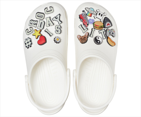This year's limited edition #CrocDay Classic Clog will come fully loaded with a curated assortment of custom #CROCDAYISLIT Jibbitz™ charms — some of which glow! ​(Photo: Business Wire)