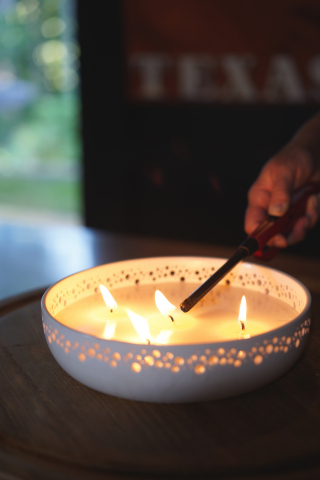 Pleasant smelling and non-toxic, citronella candles are a great way to keep insects at bay. (Photo: Exmark)