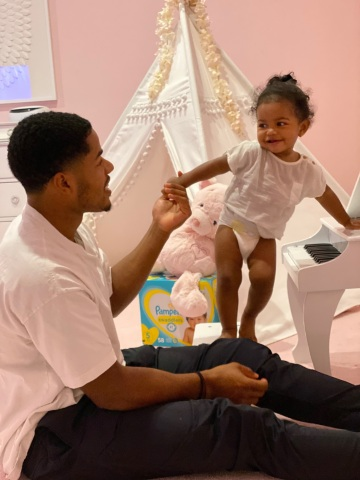 New York Giants wide receiver, Sterling Shepard, and his daughter, Cali, have partnered with Pampers to help install changing tables in public restrooms in their local community so all parents can #LoveTheChange when they're out and about with their babies. (Photo: Business Wire)