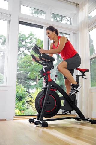 New Bowflex® C6 indoor cycling bike features an open platform, so users can connect with Nautilus, Inc.'s Explore the World™ app and third-party cycling apps including Peloton® and Zwift®. (Photo: Business Wire)