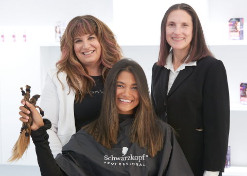 Volunteer Henkel employees, friends and family members received haircuts from Henkel stylists, all donating their hair to commemorate Breast Cancer Awareness Month. (Photo: Business Wire)